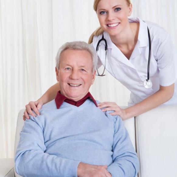 portrait-of-happy-doctor-and-patient-582x582